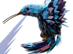 Incredible Animal Sculptures Made from Broken CDs. No, I won't be making this, but it is awesome.