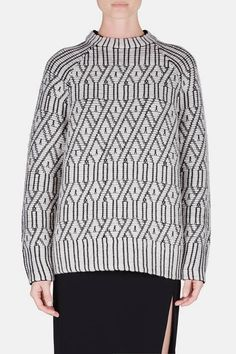 """A trompe-l'œil feat of quilted """"cable knit"""" infuses this raglan-sleeved crewneck with layers of texture—and wit. In addition to Proenza Schouler's aesthetic edge, the sweater showcases technical innovations of the pre-fall 2015 collection: each fabric was specially developed."""