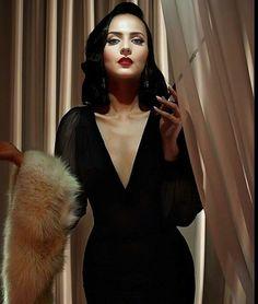 Idda van Munster...with a cigarette holder x