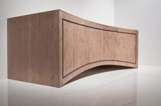 La Curva media cabinet. In oak with ebony detail. the doors open to reveal shelves and drawers.
