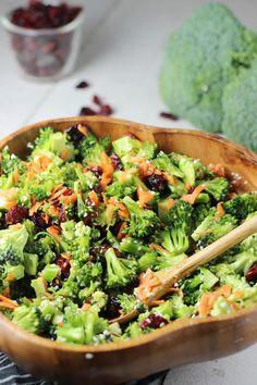 Broccoli, sesame seeds, carrots, craisins, coconut aminos, honey, rice wine vinegar, garlic powder and ginger combine for a taste that perks up broccoli.