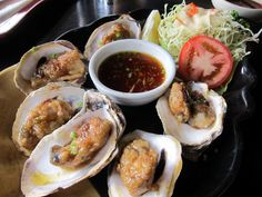 """Oyster Butteryaki """"Grilled oysters cooked in butter with ponzu sauce"""" PHP 280 Grilled Oysters, Oyster Recipes, Fresh Rolls, Sushi, Grilling, Butter, Cooking, Ethnic Recipes, Food"""