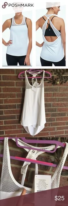 NWT Fabletics white Sol tank size XXL 2X top NEW with tag attached.  There is one small makeup spot I'm pointing to in the pictures.  I'm sure it can be washed out.  Size XXL 18-20 (6234T) Fabletics Tops Tank Tops