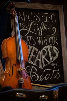 Consider a fun and unique sign like this with music themed chalkboard calligraphy!  // photography by Traci Brooks tracijbrooks.com // wolftrap.org