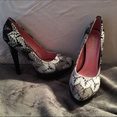 Brand new heels from shoe dazzle Black and white print ( see pictures)  5 in heel with 2 in platform. Brand new, never worn. Shoe Dazzle Shoes Heels