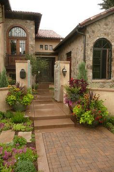 I want to do this with my house... color scheme stain concrete and pots.. all of it I have similar stone