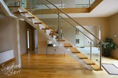 This staircase from our glider range features a 'fin-plate' support structure. The balustrade is a combination of toughened glass and stainless steel with a stainless steel handrail.