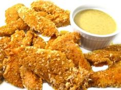 Skinny Baked Chicken Fingers with Honey Mustard Sauce. http://www.skinnykitchen.com/recipes/skinny-baked-chicken-fingers-with-honey-mustard-sauce/