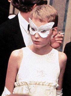 Masked Mia Farrow at Truman Capote's Black and White Ball, 1966.
