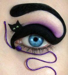 Black Cat Eye Makeup ---- funny pictures hilarious jokes meme humor walmart fails