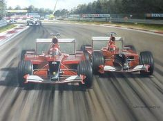Rubens Barrichello fends off Michael Schumacher both driving for Ferrari at the Italian Grand Prix September 2001.