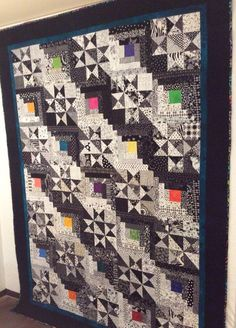 Log Cabin and Star Quilt, Black and White Modern, Batik Fabric, Multi Colored, Custom Quilted, Queen Sized, Large Lap quilt by PatchworkPartnersWA on Etsy https://www.etsy.com/listing/261945446/log-cabin-and-star-quilt-black-and-white