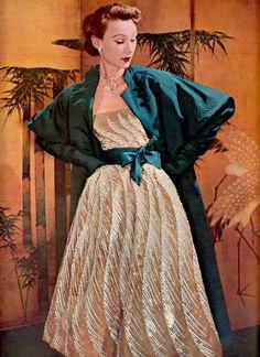 Jacques Fath ensemble. Fully embroidered  iridescent sequinned gown. Paravent (screen) by Paul Labatut.  From vintage magazine L'OFFICIEL DE LA COUTURE ET DE LA MODE DE PARIS Juin 1952 (minkshmink collection)