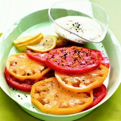 Heirloom Tomatoes with Lemon Tahini | Tahini, a sesame seed paste, becomes a dreamy dressing when enlivened with lemon zest and fresh-squeezed lemon juice. Try it on sweet heirloom tomatoes for summer's best salad.