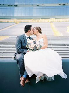 """This sweet couple said """"I Do"""" in touchdown territory: Photography : Karen Ann Photography  Read More on SMP: http://www.stylemepretty.com/wisconsin-weddings/2016/08/03/green-bay-lambeau-field-wedding/"""