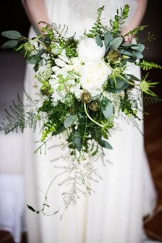 We love the ferns in this unstructured wedding bouquet. Perfect for enchanted forest wedding!