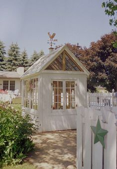 Garden shed - cute for warm climates but wouldn't be very useful in the mountains -- however, love the look.