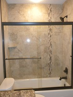 tub shower combos donu0027t have to lack style the tub to ceiling tile including an interesting vertical accent achors the space frameless shower doors - Tub Shower Doors