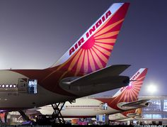 Air India Boeing 777-337/ER VT-ALS and Boeing 777-337/ER VT-ALJ at Delhi-Indira Gandhi, March 2013. VT-ALS has arrived from Mumbai and will continue to New York-JFK while VT-ALJ is in from Hyderabad on its way to Chicago-O'Hare. (Photo: Sunandan Subramaniam)
