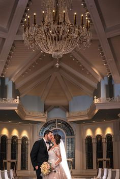 The gorgeous new chandelier in Disney's Wedding Pavilion sparkles above these newlyweds! Photo: Ali, Disney Fine Art Photography