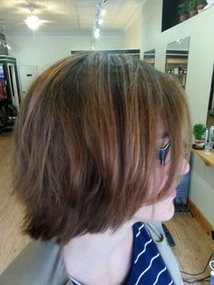 Caramel colored balayage highlights on medium length layered haircut