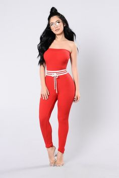 - Available in Black and Red - Tube Jumpsuit - Ribbed Knit - Waist Stripe - Drawstring - 90% Acrylic 10% Spandex