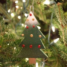Christmas Ornaments Made from Recycled Cedar Wood. Hand made and painted by adults with disabilities.