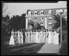 Group of African American college students in long formal dresses posing on a lawn in front of Howard University buildings at a sorority garden party.  Vintage African American photography courtesy of Black History Album, The Way We Were.  Follow Us On Twitter @blackhistoryalb