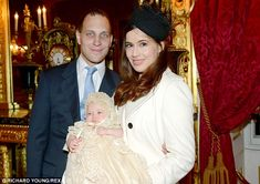 The granddaughter of Prince and Princess Michael of Kent, Maud Elizabeth Daphne Marina was christened today. She is seen here pictured with her parents Lord Frederick Windsor and his wife Sophie 16 Dec 2013