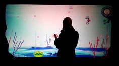 This Carnival Cruise Lines Interactive Aquarium used mobile phones as controllers for a storefront screen.Users can dial in with any mobile device and create a fish using their voice and control it using the key pad.