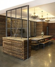 Wood and metal wall divider- open concept without closing space. I'd probably use piping for the metal.