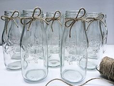 * Please check current Shop Announcement before purchase!! *  Set of 20 Glass Dairy bottles with unlimited uses! Perfect for barnyard events, country themed events, weddings, showers, etc. ! They make absolutely beautiful centerpieces with fresh or faux flowers for any event, or make the perfect little drinking glasses with colored straws! Add some milk in them for your dessert table at your event! I told ya- the uses are limitless!! Set includes 20 glass Dairy bottles, each tied with a…