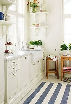 Love the white.  Next house...definitely a white kitchen!  and another farm sink.