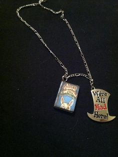 "Alice in wonderland book necklace On 16"" silver coloured chain Mad hat charm $13"