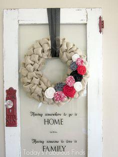Love the reused door, would do thin on a glass front door too, burlap wreath cute too