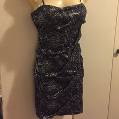 Sexy black and silver dress Great dress for a night out. Splashes of silver and black. Fitted and comes mid-thigh. Size large (it stretches) Dresses Mini