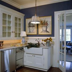 navy and blue striped wallcovering with white wainscoting, stunning