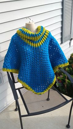 Hot Off My Hook! Project: Cowl Neck Poncho Started: 20 Sept 2016 Completed: 24 Sept 2016 Model: Madge the Mannequin Crochet Hook(s): 7mm Cowl Portion, K, Granny Stitch portion Yarn: Bernat Super Value, RedHeart Super Saver Color(s) Grass, Pool Pattern Source: Simply Crochet Magazine, Issue No. 25 (Hard Copy) Pattern Designed By: Simone Francis Notes: This is my 93rd Cowl-Neck Poncho! My Mother picked out the colors!
