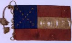 """13-star First National pattern bible flag. Found in the scrapbook of Lizze and Mary Ann Lane of Louisiana. The flag measures 3.5"""" x 6"""". Museum of the Confederacy Collection."""