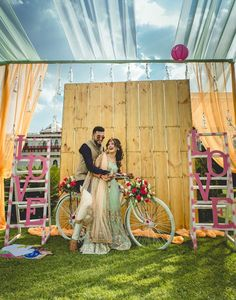 A rustic backdrop with cages flowers and photo frames | Loe alphabets in pink on ladders | Indian wedding photo booth ideas | Shutter down | The ultimate guide for the Indian Bride to plan her dream wedding. Witty Vows shares things no one tells brides, covers real weddings, ideas, inspirations, design trends and the right vendors, candid photographers etc.| #bridsmaids #inspiration #IndianWedding | Curated by #WittyVows - Things no one tells Brides | www.wittyvows.com