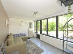 Création d'une pièce en plus en rez-de-jardin avec la véranda en 2 niveaux