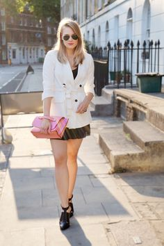 Favourite white blazer paired with black pleated shorts and black modern design heels, finished with aviator sunglasses and a pop of pink colour in the bag. Super cute! London weather at its best as well today.