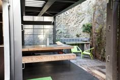 id#30074 - WellingtonContainerHouse in Wellington - Deck with rock face and waterfall - www.bookabach.co.nz/30074