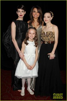 Les Mis (2012) | New York Premiere: on the Les Miserables Red Carpet, stars Anne Hathaway (Fantine), Samantha Barks (Eponine), Amanda Seyfried (Cosette) and newcomer Isabelle Allen (young Cosette).