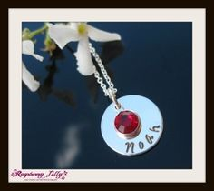 A stunning Sterling Silver .925 disc with a birthstone crystal attached.  Both on a beautiful sterling silver necklace. Just let us know what you would like stamped on it. You can use the message box in your cart or we will contact you as soon as we have received your order.  Please allow for 2-3 weeks delivery time Price INCLUDES courier.