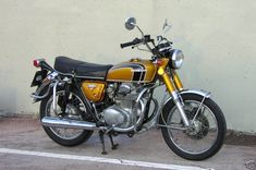 1975 Honda CB 350. first motorcycle but with a 'sissy bar' and raised handlebars