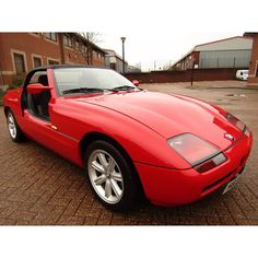 BMW Z1 (1990) - In early 1987 BMW announced that the Z1 would enter production and in September 1987 the Z1 was unveiled at the Frankfurt Motor Show. Production began in October 1988. The doors are unique in that they retract vertically. The body with its high sills offers crash protection independent of the doors and it is possible (although perhaps not legal in some countries) for the Z1 to be driven with the doors lowered. . . . . . #bmw #z1 #roadster #germany #sportscar #80s #car… Bmw Z1, Bavarian Motor Works, E30, Bmw Cars, Classic Cars, Frankfurt, Countries, September, Germany