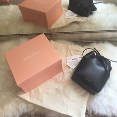"""BNWT Mansur Gavriel Mini Mini in Ballerina BNWT. SOLD OUT Mansur Gavriel Mini Mini in BALLERINA  8"""" H X 6"""" W X 3.75"""" D                         Comes with box, dust bag, and all original tags. Purchased on mansurgavriel.com Italian vegetable tanned leather black mini mini bucket bag with nude interior matte patent. Adjustable strap. Made in Italy. Can also do $525 ️️. NO TRADES  Mansur Gavriel Bags Crossbody Bags"""