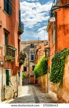 Colorful facades of old houses on street Calle Gradisca Cannaregio in Venice, Italy. Venice is a popular tourist destination of Europe.