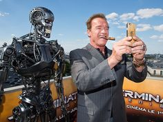 Star Tracks: Monday, June 22, 2015 | MAN OR MACHINE? | No wax figure this time! The real Arnold Schwarzenegger snaps a one-of-a-kind selfie at a photo call for Terminator Genisys Friday in Paris.